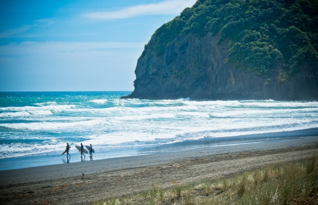Surfers on Piha